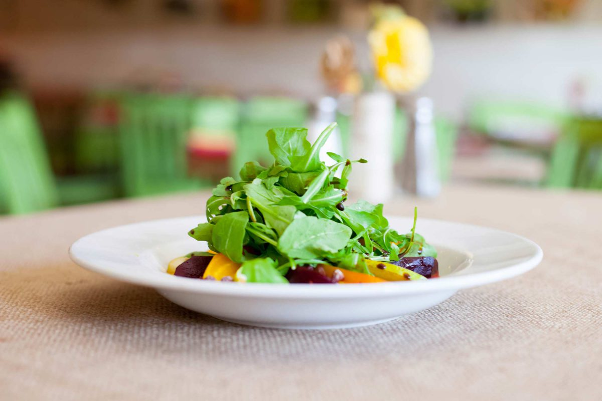 local dish salad piled high with fresh greens